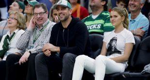 Brew-haha -- Yelich, Rodgers chug at Bucks game