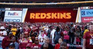 Redskins stadium sign next to FedEx logo