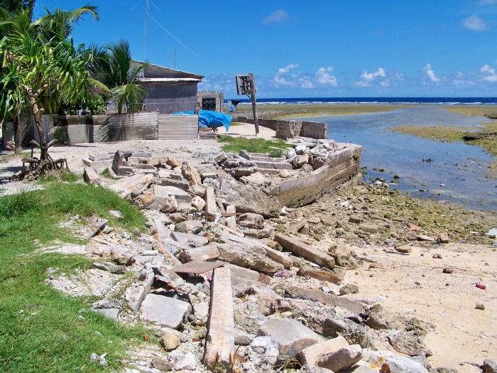 The ruins of a sea wall on a coastline.